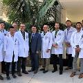 Thomas G. Harris, MD, with orthopaedic residents at Community Memorial Hospital in Ventura, California