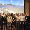 Eric M. Bluman, MD, PhD, (front row in yellow shirt) visited the Tripler Army Medical Center in Hawaii and presented at the Tripler/University of Hawaii combined orthopaedic symposium.