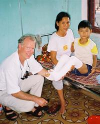 Pierce Scranton, MD, with patients in Vietnam